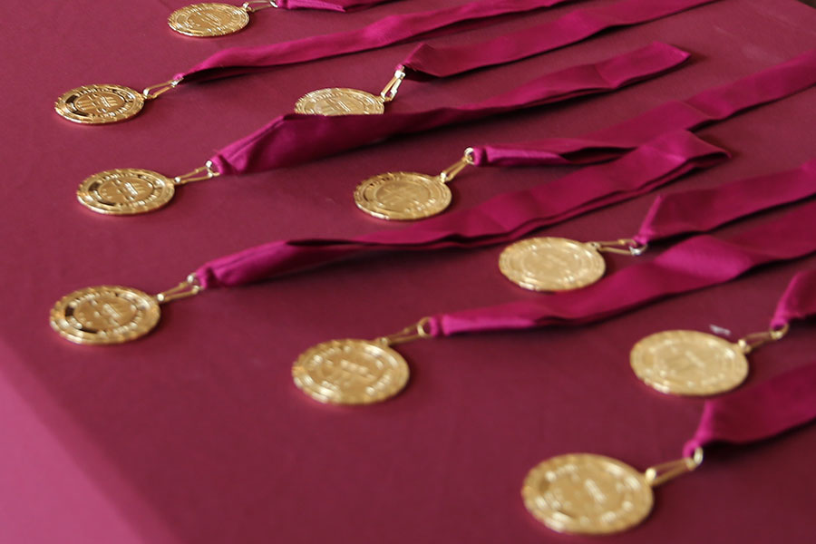 Honors Medallions on garnet tablecloth